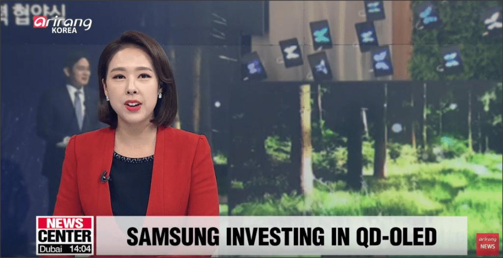 zdjęcie z programu informacyjnego, który podaje wiadomość, że Samsung inwestuje w QD OLED