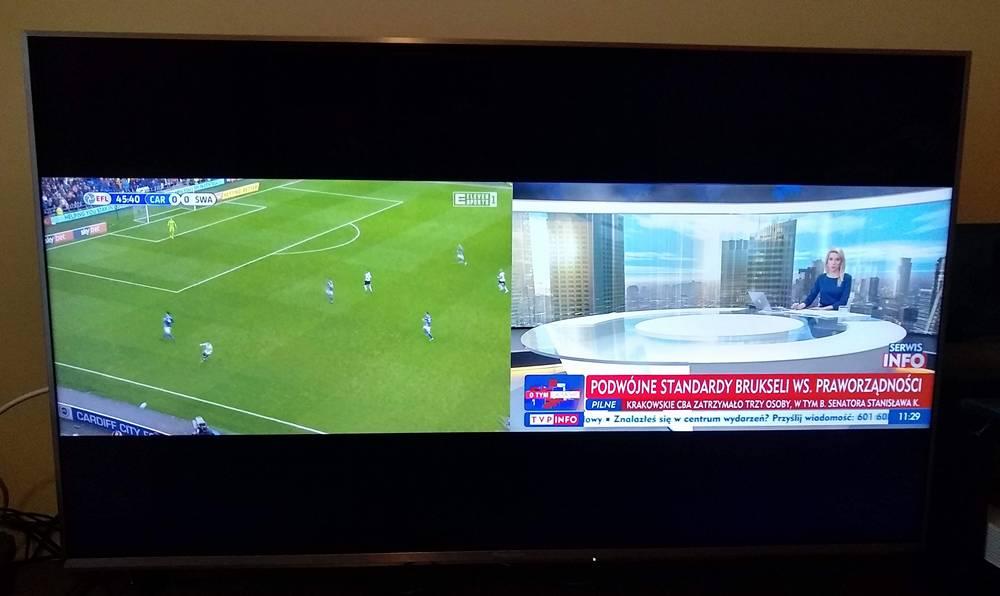 na ekranie telewizora Panasonic wyświetlają się treści z dwóch kanałów - mecz oraz program informacyjny